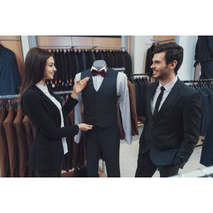 Beautiful elegant girl demonstrates how to select a perfect 3 piece suit for men