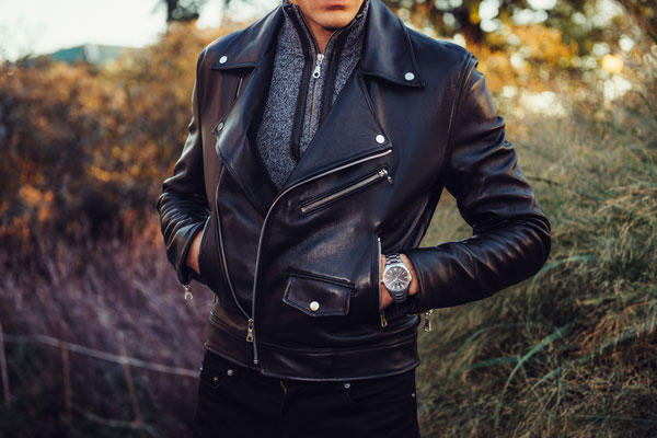 Man wearing black mens leather jacket and watch posing outdoors HappyGentleman