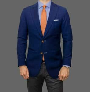 Blue mens blazer jackets style. Men dressed with a blue blazer jacket, blue shirt and orange tie - Happy Gentleman