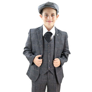 Boy dressed with grey 3 piece tweed boy's suits, and peaky blinders hat and ready for wedding event