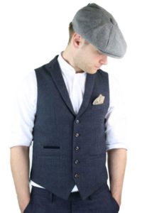 Men dressed in blue vintage tweed waistcoat for men with a grey tweed hat and white formal shirt
